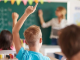 classroom, raised hands